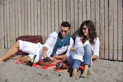 Young couple enjoying  picnic on the beach Royalty Free Stock Photography