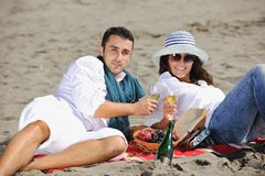 Young couple enjoying  picnic on the beach Stock Image
