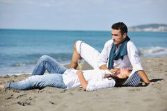 Young couple enjoying  picnic on the beach Stock Images