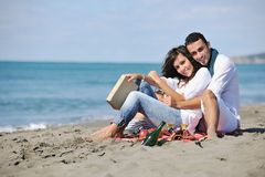Young couple enjoying  picnic on the beach Royalty Free Stock Images