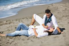 Young couple enjoying  picnic on the beach Royalty Free Stock Photos