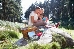 Young Couple Enjoying Picnic In Countryside Stock Photography