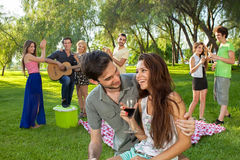 Young couple enjoying a picnic with friends Stock Photo