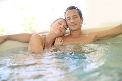 Young couple enjoying and relaxing in spa Royalty Free Stock Photos