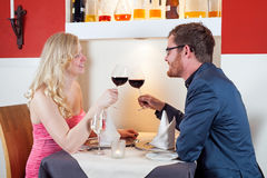 Young couple enjoying a romantic dinner Royalty Free Stock Photo