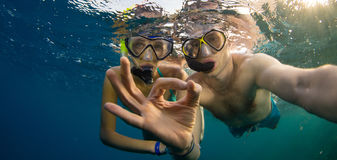 Young couple enjoying snorkeling underwater. Selfie portrait. Travel lifestyle, water sport outdoor activities, swimming and snorkeling on summer beach royalty free stock photos