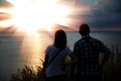 Young couple enjoying the sunset. Stock Images