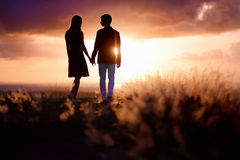 Young couple enjoying the sunset Royalty Free Stock Images