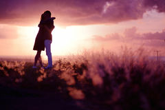 Young couple enjoying the sunset Royalty Free Stock Photos