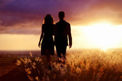 Young couple enjoying the sunset Royalty Free Stock Photography