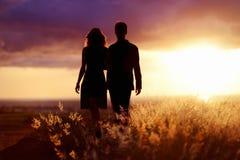 Young couple enjoying the sunset Royalty Free Stock Photography