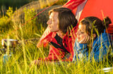 Young couple enjoying sunset from tent Royalty Free Stock Photography
