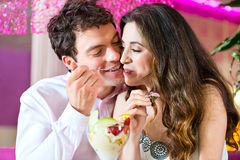 Young couple enjoying their time in ice cream parlor Stock Photography