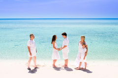 Young couple enjoying their wedding anniversary. With child and parents Stock Photos