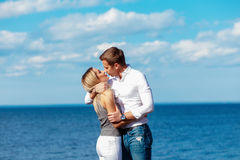 Young couple enjoying themselves on a beach . Romantic couple in love Stock Image
