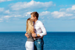 Young couple enjoying themselves on a beach . Romantic couple in love Royalty Free Stock Photos