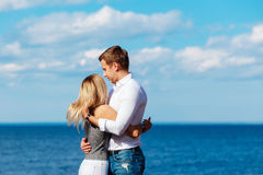 Young couple enjoying themselves on a beach . Romantic couple in love Stock Images