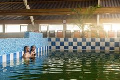 Young couple enjoying the thermal water in spa Stock Photos