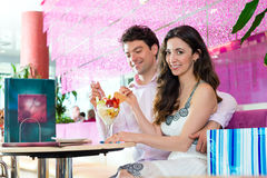 Young couple enjoying time in ice cream parlor Royalty Free Stock Photography