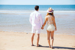 Young couple enjoying the view in a beach Royalty Free Stock Image