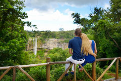 Young couple enjoying a view on Chamarel falls Stock Photos