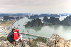 Young couple enjoying the view of Halong Bay from the top of the mountain Royalty Free Stock Images