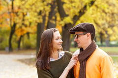 Young couple enjoying a walking in park Stock Photos