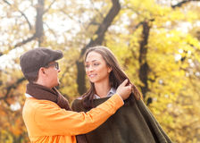 Young couple enjoying a walking in park Royalty Free Stock Photos