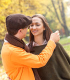 Young couple enjoying a walking in park Stock Image
