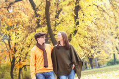Young couple enjoying a walking in park Royalty Free Stock Image