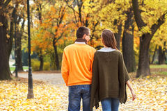 Young couple enjoying a walking in park Royalty Free Stock Photography