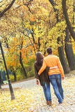 Young couple enjoying a walking in park Royalty Free Stock Images