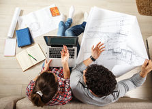 Young couple examining blueprints Stock Image