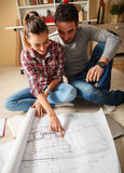 Young couple examining blueprints Stock Photography
