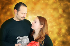 Young couple exchanging  gifts Stock Image