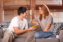 Young couple exchanging presents Royalty Free Stock Photography