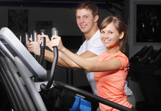 Young couple on exercise bicycle Royalty Free Stock Image