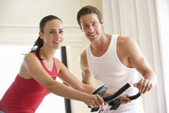 Young Couple On Exercise Bike Stock Photo