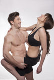 Young couple exercise together. Young fitness couple in the studio Stock Image