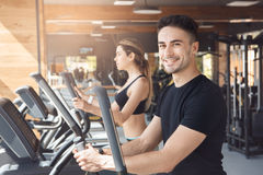 Young couple exercise together in gym healthy lifestyle Stock Photography
