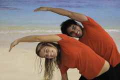 Young couple exercising on a beach Stock Image