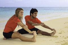 Young couple exercising on a beach Stock Photo