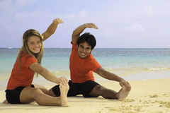 Young couple exercising on a beach Stock Photography