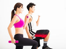 Young  couple exercising with dumbbell Royalty Free Stock Images