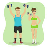 Young couple exercising with dumbbells together Royalty Free Stock Photography