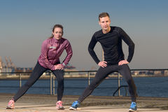 Young couple exercising at the waterfront Stock Photo