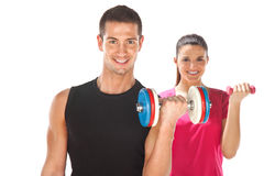 Young man and woman lifting weights. Isolated on white Stock Photo