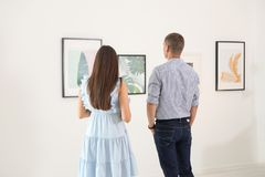 Young couple at exhibition. In art gallery royalty free stock photo