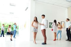 Young couple at exhibition. In art gallery royalty free stock photography