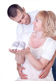Young couple expecting a baby. Studio shot of young couple expecting a baby Royalty Free Stock Photo